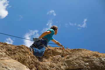 the rock-climber climbs difficult marshnut on the rock