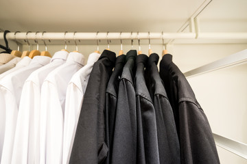 white and black men shirts in closet