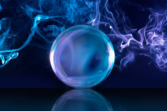 crystal ball in a dark blue smoky background