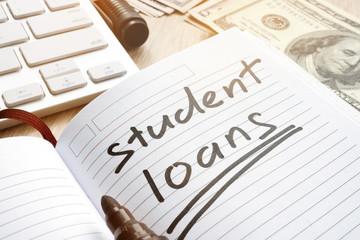 Student loan handwritten in a note. Money for education.