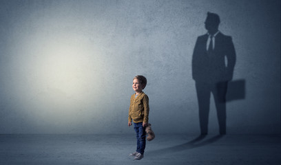 Little boy with businessman shadow