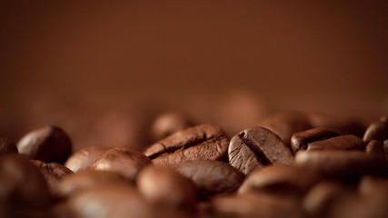 Fotobehang Koffiebonen macro of coffee beans in studioshoot on brown