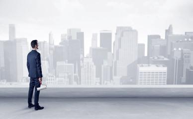 Businessman looking at a big city panorama