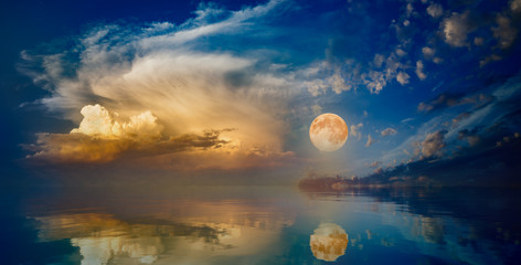 Full moon rising above serene sea in sunset sky Wall mural
