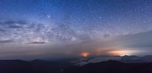 "the milky way at ""SAN NOK WUA"" Khao Laem National Park, beautiful from the highest peaks of the mountains, Kanchanaburi, Thailand. SAN NOK WUA is highest mountain in Kanchanaburi."