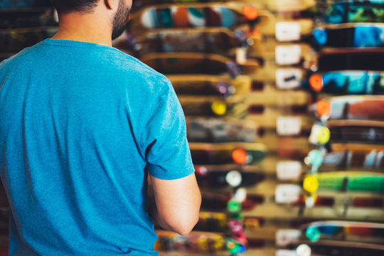Assortment skateboard isolated in store shop, person choosing and buy color skates on backgraund sun flare, healthy and activity lifestyle concept close up, man consider sport board for driving