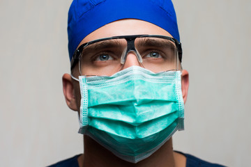young surgeon on white background