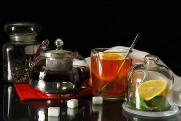 A Cup of tea, teapot and lemon
