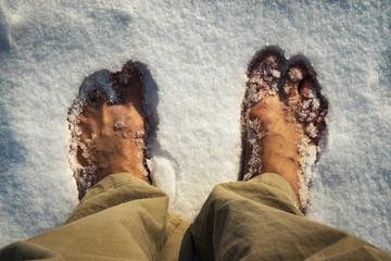 bare feet in white snow