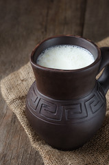 Fresh milk in a clay pitcher.
