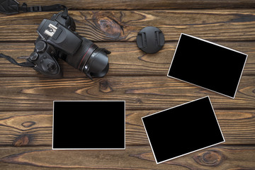 mock up photos, a camera on the background of a wooden table. Family photo album
