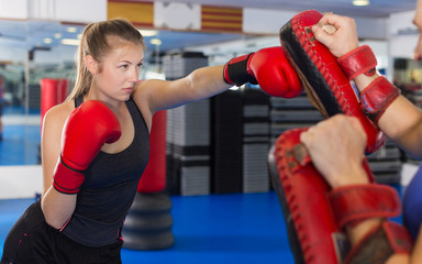Woman boxer is training