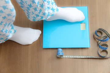 Female legs, Legs of woman standing on scales weight. Concept of health and weight loss.