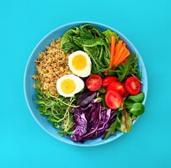 Fresh juicy and crusty buddha bowl healthy meal with quinoa and green sprouts
