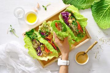 Vegan detox spring rolls with quinoa, sprouts and Thai peanut sauce