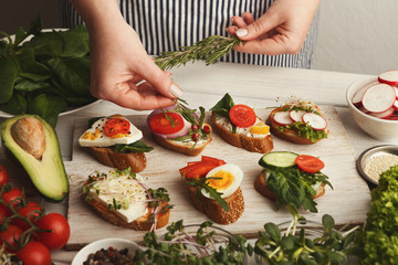 Aluminium Prints Picnic Feamale hands making healthy bruschettas for right snack