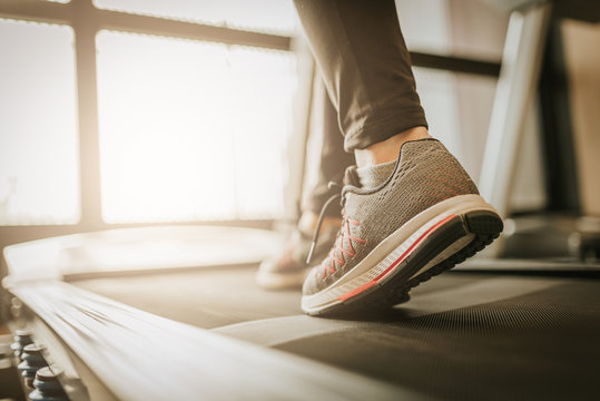 woman leg running in a gym on a treadmill