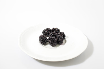 Blackberries in a white background composition