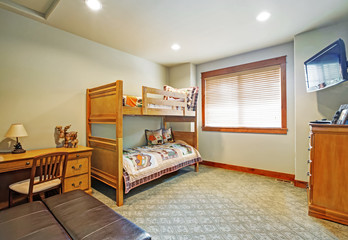 Kids' bunk room features bunk bed