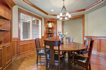Sweet dining room interior with lots of woodwork details.