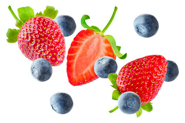 Fresh flying strawberries and blueberries