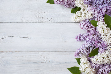 Garden Poster Lilac A wooden background with flowering lilac branches