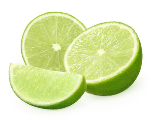 Halves and slice of fresh lime fruit isolated on white