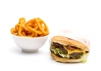 Real Life Hamburger and Seasoned Curly Fries on a White Background