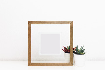 Wooden frame mock up with succulents pots. Nordic Scandinavian style home interior