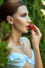 Fashionable passion woman eating red sweet strawberry