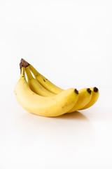 Three ripe, unpeeled, organic and yellow Cavendish bananas on white background