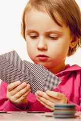Poker Rules: The little child girl gambler learning to Play Poker Games.