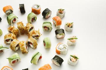 Japanese sushi rolls, maki on white background