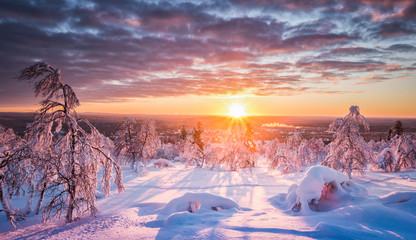 Winter wonderland landscape in Scandinavia at sunset