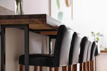 Wooden counter and chairs in cafe