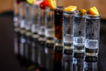 A shots of alcohol are reflected on the surface.