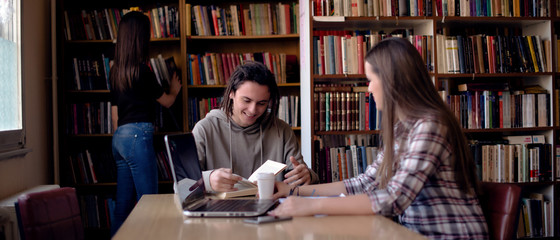 Cropped image of students learning in library