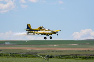 Crop Duster spraying field