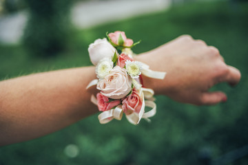 floral a bracelet on the hand grass background