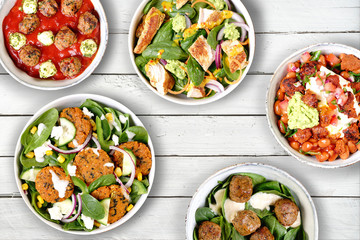various salad bowls meatballs green mains starter diet light dish from above table few many choice healthy organic