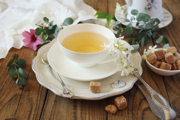 Summer composition: Romantic tea drinking with jasmine green tea