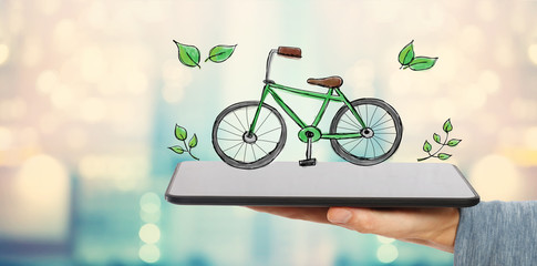 Eco Bicycle with man holding a tablet computer