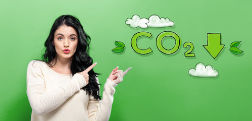 Reduce CO2 with young woman on a green background