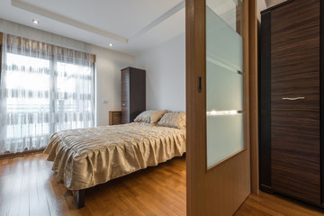 Interior of a luxury loft bedroom with master bed