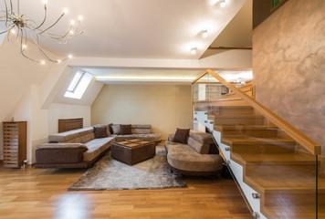 Open plan living room interior in luxury loft apartment