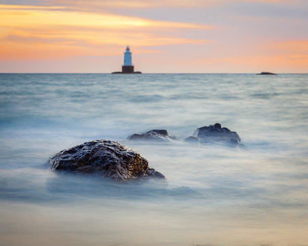 Rocky Coastal Lighthouse Seascape at Sunset