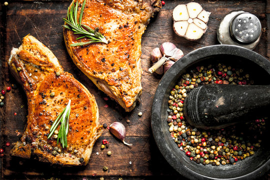 Grilled pork steak with spices.