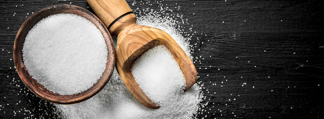 Salt in a wooden bowl.
