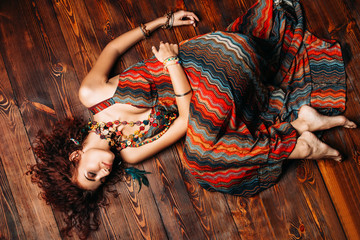 lying on wooden floor