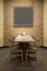 dinner table and blank frame reserve for customer